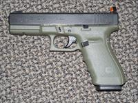 "GLOCK MODEL 21 IN BATTLEFIELD GREEN .45 ACP PISTOL WITH ""SNAKE EYES"" TACTICAL SIGHTS"