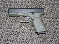 "GLOCK MODEL 19 ""BATTLEFIELD GREEN"" 9 MM 4TH GEN PISTOL"