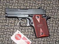 SIG SAUER P-938 IN 9 MM BLACK WITH ROSEWOOD GRIPS AND NIGHTSIGHTS