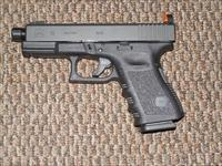GLOCK 19 CUSTOM WITH THREADED BARREL AND SNAKE-EYES SIGHTS