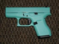 GLOCK .380 ACP MODEL 42 FINISHED IN ROBIN EGG BLUE