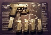 S&W M&P Shield .40 caliber with 5 mags + Crimson Trace green laser and TekMat