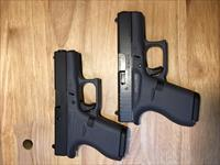2 SEQUENTIALLY NUMBERED GLOCK 42 .380s - IN FACTORY GRAY - HIS & HER'S?!