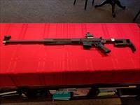 Bushmaster XM15-E2S W/ 28'' match barrel and C. Hawkins sight!!