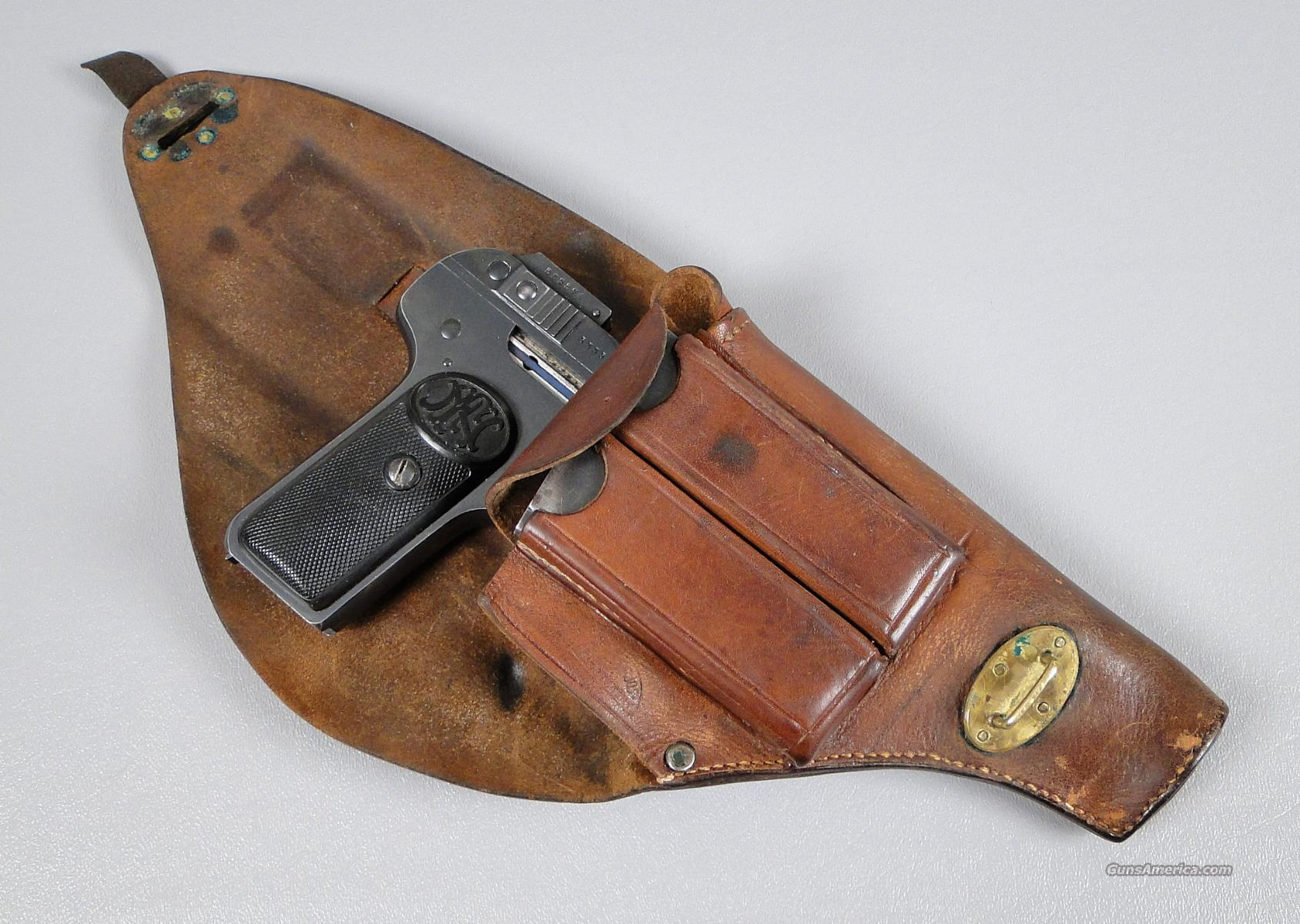 Fn browning model 1900 32 acp pistol with extra magazine and military