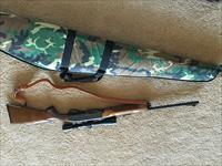 Remington Model 7400 30-06 with Leupold scope, two 4 round clips, cloth case and strap