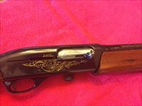Remington 1100 12 GA semi-auto Shotgun with GOLD engraving. Beautiful and Functional!!