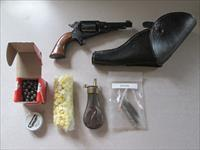 Pietta 31 caliber remington pistol, holster, cleaning kit, balls, flask & wonder wads