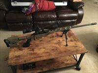 Savage 110, lapua mag, with cadex frame