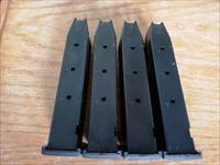 Four used Beretta 92fs magazines 15 rounds