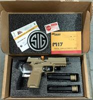Sig Sauer M17 - P320 9mm commemorative edition pistol new in box with additional custom wood/glass display case, M17 silver medallion, extra long clips, 2 boxes NATO 9mm ammunition, extras.