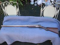 AMERICAN ARMS DOUBLE BARREL SWING OUT 12 GUAGE SHOTGUN WITH ORIGINAL LEATHER CASE