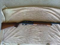 "Remington 1100, 12ga, 28"" barrel threaded for chokes."
