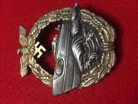 Kriegsmarine E-boat badge 2nd type. These are dye-struck featuring superb detail with a wide pin and makers mark.