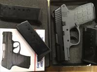 Kel-Tec PF-9 Like New.  Includes 4 Magazines