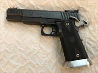 STI Eagle 5.0 9 mm with four magazines. Has front slide minor holster wear and minor scratches on base of front sight.