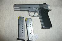 S&W  model 10 06  10MM AUTOMATIC    3 MAGS APPEARS UN-FIRED