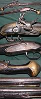 large flintlock Mediterranean pistol with metal plating around lock