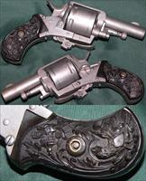 European double action centerfire folding trigger revolver with fancy eagle grips