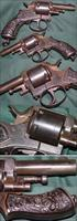 European double action centerfire revolver with fancy Cherub grips