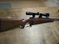 Remington model Seven 7mm-08 with 4x12x40 Bushnell scope