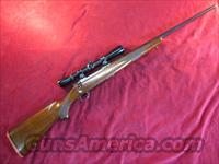 RUGER M77 BOLT ACTION 7MM MAG W/ SCOPE USED