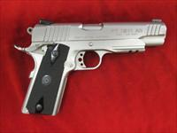 TAURUS STAINLESS 1911 IN 45ACP W/TAC RAIL USED