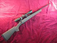 HOWA MODEL 1500 RANCHLAND SECURITY RIFLE 223 W/ GREEN HOGUE STOCK AND SCOPE USED