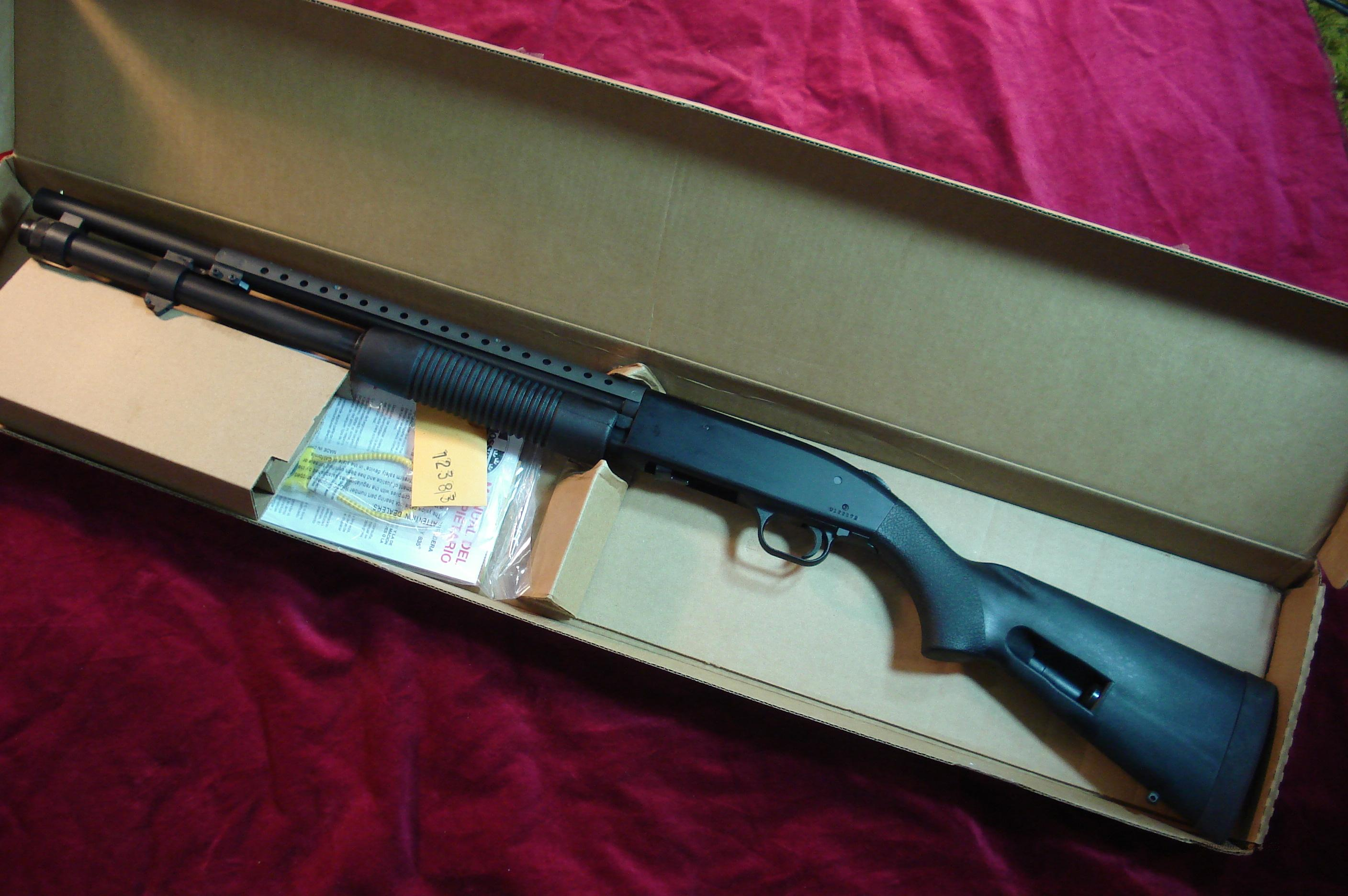 MOSSBERG 590 PERSUADER 12G W/SPEED FEED STOCK,HEAT SHIELD AND MAG   EXTENTION NEW