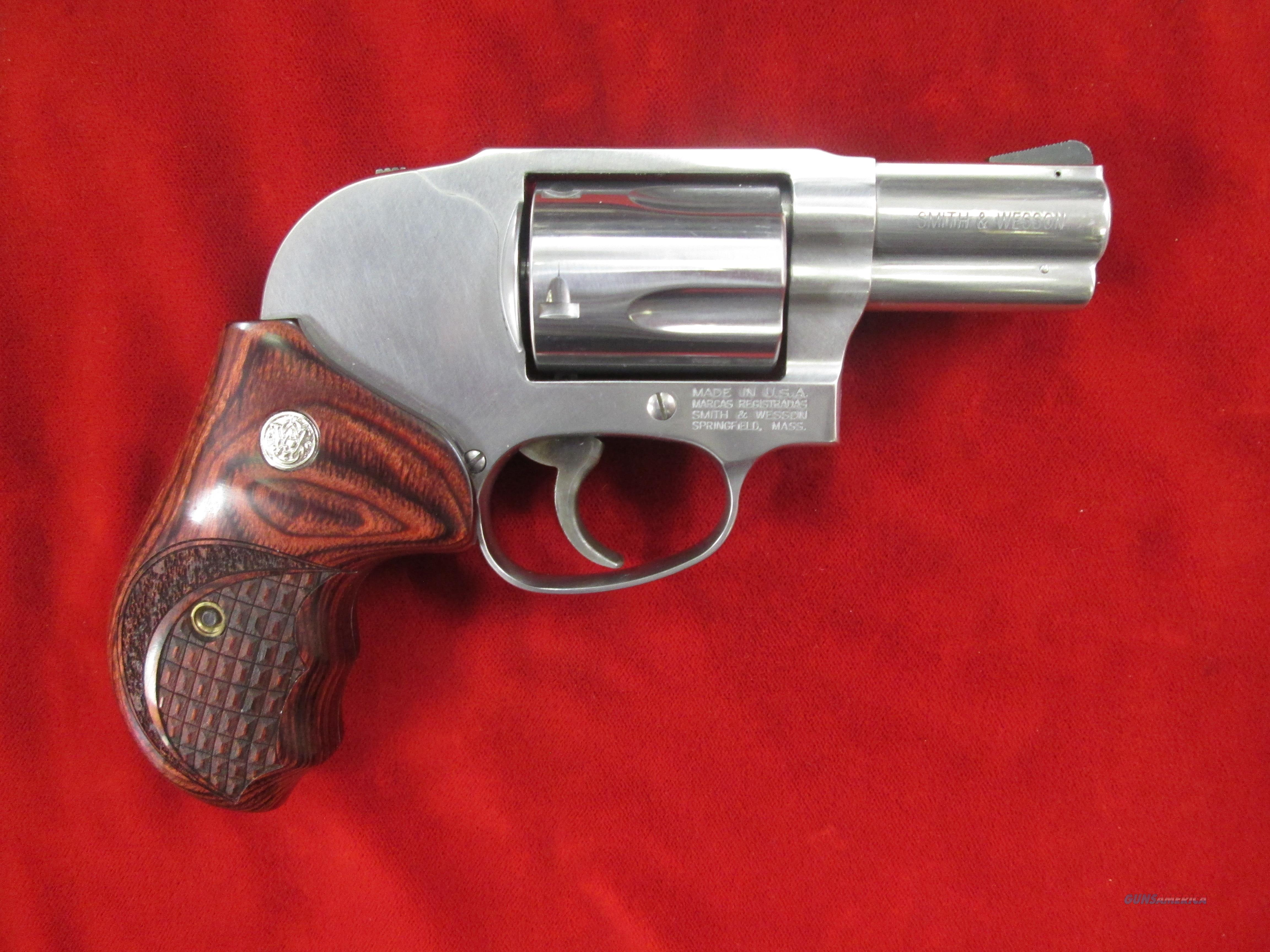 SMITH AND WESSON MODEL 649 STAINLESS  357 MAG W/ SHROUDED HAMMER AND WOOD  GRIPS NEW (163210)