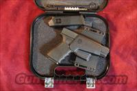 GLOCK 23 W/GLOCK NIGHT SIGHTS AND GLOCK COMBAT HOLSTER TWO 10 ROUND MAGS NEW