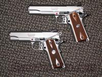 RUGER PAIR OF 1911 PISTOLS WITH FULL-SIZE AND COMMANDER-SIZED .45's