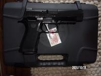 Sar 9MM with 2-17 rd mags. New in box