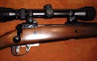 Savage, Model 111, bolt action  rifle, 30-06,   Accutrigger,  walnut finished hard wood stock