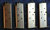 4 Colt Mustang mags. Nickel plated 6 round factory
