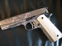 Ruger SR1911,Commander size,fully deep hand engraved by Flannery Engraving,45auto,polished stainless,real Bison bone checkered grips,2 mags,box,manual,soft case etc..one of a kind masterpiece !!!