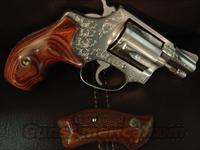"Smith & Wesson model 60 no dash,2"" pinned barrel,lightly engraved,satin stainless,38 special,Chiefs special,new custom rosewood combat grips & original grips,made around 1969"