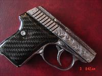 Seecamp LWS 380, fully engraved & polished by Flannery Engraving,Carbon Fiber grips,box,manual,& certificate. 1 of a kind work of art !!