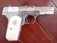 Colt 1908,380 auto,Master engraved by S.Leis,made in 1915,refinished bright nickel,bonded ivory grips,hammerless,a rare work of art-awesome 1 of a kind !!certificate also.