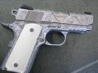"Colt Defender,fully engraved by Flannery Engraving,just awesome!! Bison bone checkered grips,3""barrel 45acp,white dot sites,Box,manual,2 mags,polished stainless slide--1 of a kind !!"