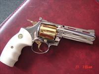 "Colt Diamondback 4"",fully refinished in bright mirror nickel & 24K gold accents,Bonded ivory grips,38 special,made in 1975,awesome showpiece. nicer in person !!"