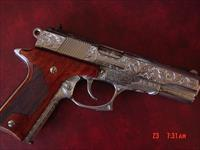 Colt Double Eagle 10MM, fully engraved & polished by Flannery Engraving,custom wood grips,certificate, a one of a kind work of art !!