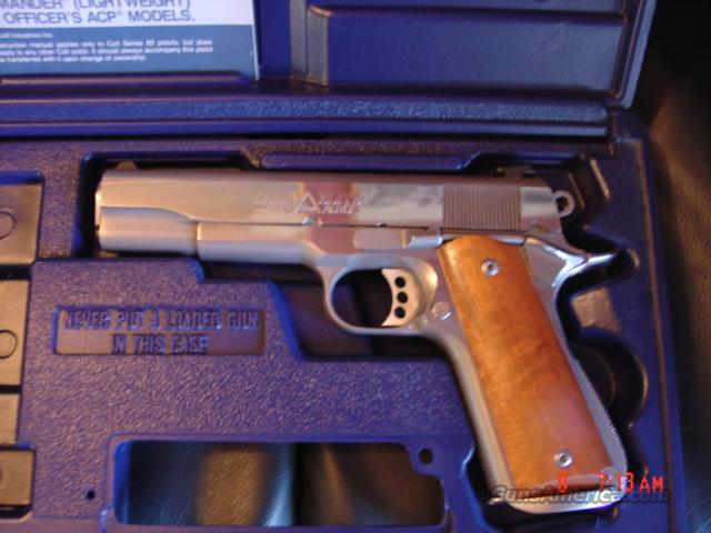 Colt Delta Elite 1911-wood grips,polished stainless,bev mag well,night  sights,box & manual