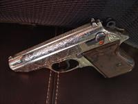 Walther PPK deep scroll engraved,nickel,9mm short/380 auto,2 mags,original box,target & manual,around 50 years old