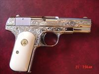Colt 1903 Hammerless, 32ACP, master engraved by S.Leis,& refinished in bright nickel, with bonded ivory grips,1920,awesome showpiece !!