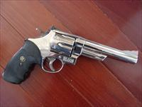 "Smith & Wesson 29-2,44 magnum,polished mirror nickel,6""barrel,wood case,around 35 years old.,very clean"