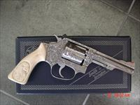 "Smith & Wesson 63 no dash,4"" 22LR,Deep hand engraved by Willy B's customs,real carved ivory grips,box,papers etc..a one of a kind work of art !!"