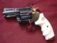 "Colt Diamondback,rare 2 1/2"" barrel,refinished bright blue with 24k gold accents,made 1971,bonded ivory,38 special,awesome showpiece !!"