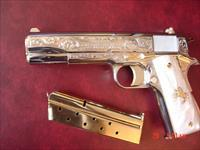 Colt Government 38 Super,master engraved by S.Leis with certificate,refinished bright nickel & gold accents,Pearlite grips,never fired. 1 of a kind showpiece !