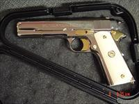 Colt 1911 Commercial,Government,fully refinished in bright nickel with 24k gold accents,bonded ivory grips,made in 1921,45acp,a real showpiece !!